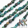 Tumbled beads in the shape of nuggets made of natural chrysocolla with a diameter of 5-8 and a length of 5-8 mm with a hole for a thread with a diameter of 1 mm. The beads are absolutely natural without any dye. Country of origin: China THE PRICE IS FOR 1 PCS.