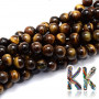 Tumbled round beads made of mineral tiger eye with a diameter of 6 mm with a hole for a thread with a diameter of 1 mm. The AB quality of the beads indicates imperfect bead coloration and possible minor shape imperfections. Country of origin: South Africa THE PRICE IS FOR 1 PCS.