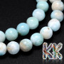 Tumbledround beadsmade from the rarest mineral on the planet - larimar or dolphin stone. The beads have a diameter of 6 mm and a hole for a thread with a diameter of 1 mm. The beads are absolutely natural, without any dye. Country of origin: Dominican Republic THE PRICE IS FOR 1 PCS.