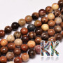 Tumbled round beads made of petrified wood with a diameter of 6 mm with a hole for a thread with a diameter of 1 mm. The beads are completely natural without any dye. Country of origin: Africa - not specified by the manufacturer THE PRICE IS FOR 1 PCS.