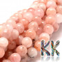 Tumbled round beads made of natural mineral morganite in its most typical pink color with a diameter of 8 mm with a hole for a thread with a diameter of 1 mm. The color composition of the beads on the strings is variable and the color ratio will always be different. The beads are completely natural without any dye. Country of origin: Nigeria THE PRICE IS FOR 1 PCS.