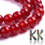 Tumbled round beads made of natural cracked chalcedony imitating agate in a deep red color with a diameter of 8 mm and with a hole for a thread with a diameter of 1 mm. The beads are natural and are dyed and heated for better color stability. Country of origin: China THE PRICE IS FOR 1 PCS.