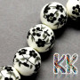 Polished porcelain beads with a print in the shape of flowers with a diameter of 8 mm and a thread with a width of 2 mm. The beads are made of genuine Chinese porcelain and are handmade. THE PRICE IS FOR 1 PCS.