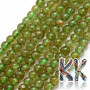 Tumbled round beads made of natural mineral green apatite with a diameter of 4 mm with a hole for a thread with a diameter of 1 mm. The beads are completely natural without any dye. Country of origin: Brazil THE PRICE IS FOR 1 PCS.