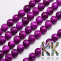 Tumbled round beads in the shape of balls made of dyed natural mineral Malaysian jade imitating natural sugilite with a diameter of 8 mm with a hole for a thread with a diameter of 1 mm. The beads are completely natural and have been dyed and heated. Country of origin: China THE PRICE IS FOR 1 PCS.