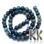 Tumbled round beads made of natural mineral apatite with a diameter of 6 mm with a hole for a thread with a diameter of 1 mm. The beads are completely natural without any dye. Country of origin: South Africa THE PRICE IS FOR 1 PCS.