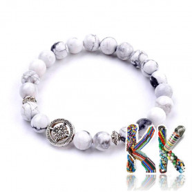 Bracelet made of natural howlite beads with separating bead made of zinc - 29