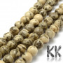 Tumbled round beads made of natural mineral feldspar in light yellow color with a decor with a diameter of 8 mm and a hole for a thread with a diameter of 1 mm. The beads are absolutely natural without any dye and their surface is protected by clear wax. Country of origin: China THE PRICE IS FOR 1 PCS.