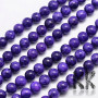Tumbled round beads made of dyed natural mineral Malaysian jade imitating natural charoite with a diameter of 8 mm with a hole for a thread with a diameter of 1 mm. The beads are completely natural and have been dyed. Country of origin: China THE PRICE IS FOR 1 PCS.