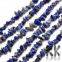 Tumbled beads in the shape of small fragments of natural sodalite measuring 5 x 8 - 5 x 8 mm and with a hole for a thread with a diameter of 1 mm. The beads are absolutely natural without any dye. 1 g contains about 3 pieces (which represents about 1 cm when stringing fragments on a string). Country of origin: Brazil THE PRICE IS FOR 1 g.