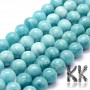 Tumbled round beads made of natural dyed mineral jade imitating amazonite with a diameter of 8 mm with a hole for a thread with a diameter of 0.8 mm. The beads are absolutely natural and have been surface-colored. Country of origin: China THE PRICE IS FOR 1 PCS.