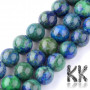 Tumbled round beadsmade of chrysocolla with lapis lazuli with a diameter of8 - 9 mm with a hole for a thread with a diameter of 1 mm. The beads have beautiful decors similar to real natural minerals, but they were created by human activity and are dyed. Country of origin: Chile THE PRICE IS FOR 1 PCS.