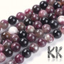 Tumbled round beads made of tourmaline mineral in purple-black colors with a diameter of 8 mm with a hole for a thread with a diameter of 1 mm. In addition to the colors in the illustration photos, the beads can also have shades of clear, white, yellow, orange, green, or brown. The beads are completely natural without any dye. Country of origin: Brazil THE PRICE IS FOR 1 PCS.