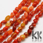 Tumbled beads in the shape of nuggets made of natural carnelian mineral with dimensions 9-14 x 9-10 x 7-10 mm with a hole for a thread with a diameter of 1 mm. The beads are absolutely natural without any dye and their vibrant color was achieved by heating. Country of origin South Africa THE PRICE IS FOR 1 PCS.