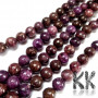 Tumbled round beads made of natural mineral lepidolite (purple mica variety) with a diameter of 10 mm with a hole for a thread with a diameter of 1 mm. The beads are completely natural without any dye. THE PRICE IS FOR 1 PCS.