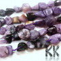 Tumbled beads in the shape of nuggets from one of the rarest minerals - natural charoite measuring 3-14 x 2-9 x 2.5-8 mm with a hole for a thread with a diameter of 1 mm. The beads are absolutely natural without any dye. Country of origin: Russia THE PRICE IS FOR 1 PCS.