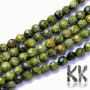 Tumbled and faceted round beads made of natural mineral serpentine with a diameter of 8 mm with a hole for a thread with a diameter of 1 mm. The beads are absolutely natural without anydye. Country of origin China THE PRICE IS FOR 1 PCS.