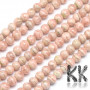 Tumbled round beadsmade of natural mineral rhodochrosite with a diameter of 6 mm with a hole for a thread with a diameter of 1 mm. The beads are completely natural without any dye. Country of origin Argentina, China THE PRICE IS FOR 1 PCS.