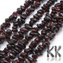 Tumbled beads in the shape of small fragments of natural garnet measuring 5-8 mm and with a hole for a thread with a diameter of 0.5 mm. The beads are absolutely natural without any dye. Country of origin: India 1 g contains about 5 pieces (which represents about 1.5 cm when stringing fragments on a string). THE PRICE IS FOR 1 g.