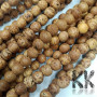 The beads are made of the fruits or wood of the rare and sacred ficus religiosa, under which the Buddha attained enlightenment. The beads have a diameter of 9 mm and a hole for a thread with a diameter of 1 mm. The beads are completely natural, without any coloring.Country of origin: IndiaTHE PRICE IS FOR 1 PCS.