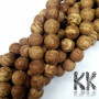 The beads are made of the fruits or wood of the rare and sacred ficus religiosa, under which the Buddha attained enlightenment. The beads have a diameter of 10 mm and a hole for a thread with a diameter of 1 mm. The beads are completely natural, without any dye. Country of origin: India THE PRICE IS FOR 1 PCS.