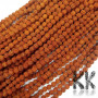 Beads made of rudraksha tree nuts with a diameter of 8 mm and a hole for a thread with a diameter of 0.5-1 mm. These are called 5 mukhi rudraksha beads. The beads come from India and may differ by up to 0.8 mm from the stated size due to manual sorting. The beads are stained with an extract of root vegetable dyes, which has traditionally been used in India to protect beads for hundreds of years.THE PRICE IS FOR 1 PCS.