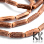 Coconut shell beads in the shape of a barrel with a diameter of 2.5-4 mm, a length of 14-19 mm and a hole for a thread with a diameter of 1 mm. The beads are completely natural, without any dyeing. THE MENTIONED PRICE IS FOR 1 STRAND/ CCA 48 PCS