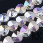 Heart-shaped faceted clear glass bead with a 14 x 14 x 8.5 mm plated surface and a hole for a 1 mm diameter thread. The beads are plated in a violet-silver reflection, which also refracts the light, and when turned, you can see other colors of the visible spectrum. THE PRICE IS FOR 1 PCS.