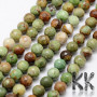 Tumbled round beads made of natural opal mineral in green color with a ground surface with a diameter of 6 mm and a hole for a thread with a diameter of 1 mm. The beads are completely natural without any dye. Country of origin: Africa - not specified by the manufacturer THE PRICE IS FOR 1 PCS.