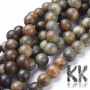 Genuine green sandalwood beads with a diameter of 6 mm and a hole for a thread with a diameter of 1 mm. The beads are absolutely natural, without any dyeing and have their typical sandalwood scent. Country of origin Mexico THE PRICE IS FOR 1 pc.