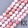 Tumbled round beads made of natural opal mineralpinkvariation with a diameter of 8 mm and a hole for a thread with a diameter of 1 mm. The beads are completely natural without any dyeing. Country of origin: Chile, Mexico, Peru THE PRICE IS FOR 1 PCS.